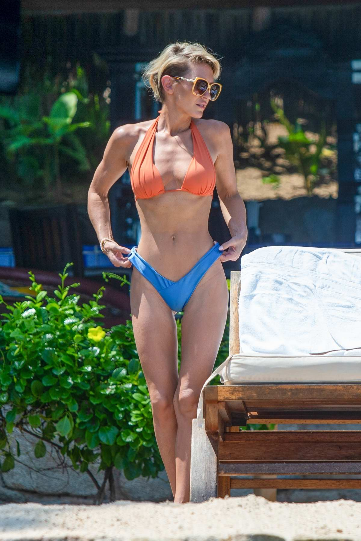 Nicky Whelan shows off her beach body in an orange and blue bikini while on vacation in Puerto Vallarta, Mexico