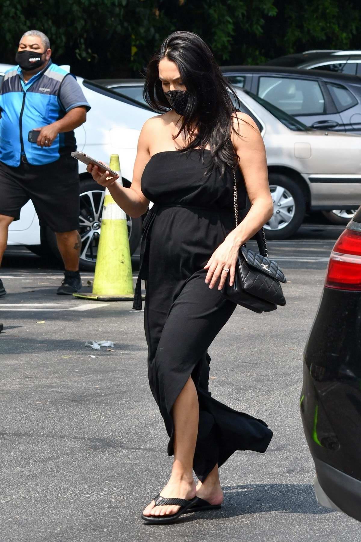 Nikki Bella seen wearing a black strapless dress during a shopping trip to Whole Foods in Studio City, California