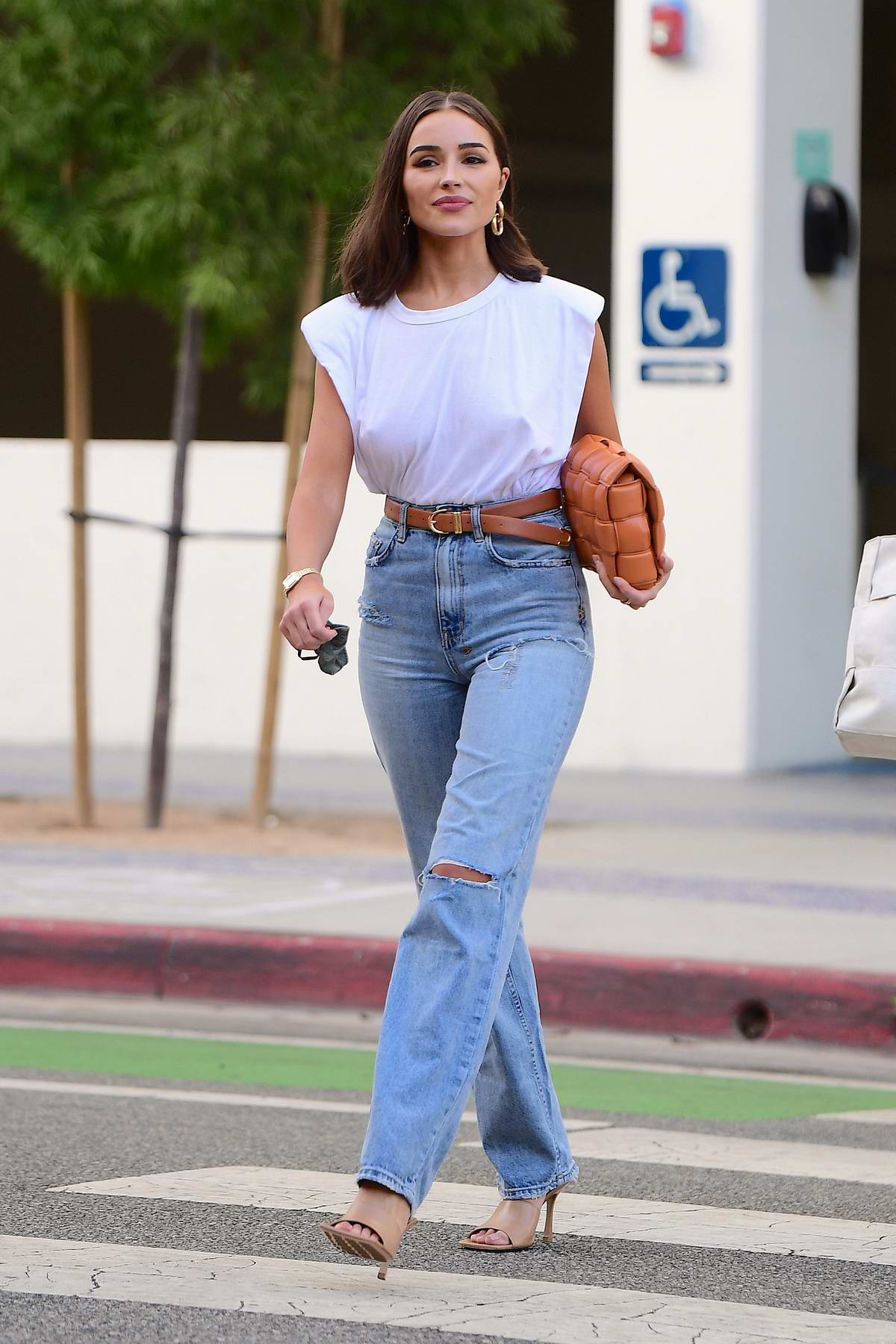 Olivia Culpo looks chic as she steps out for dinner with friends in Santa Monica, California