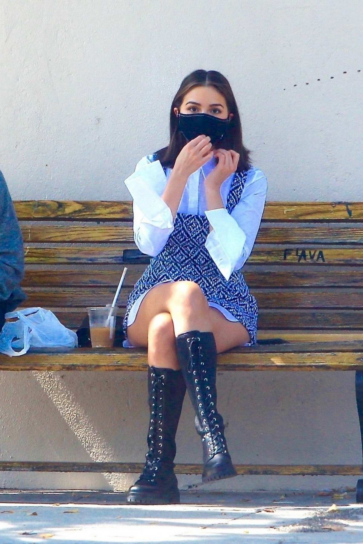 Olivia Culpo looks chic while out enjoying coffee with a friend on a public bench in Hollywood, California