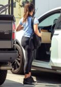 Olivia Munn looks fit in a blue tee and black leggings as she leaves the gym after her workout session in Los Angeles