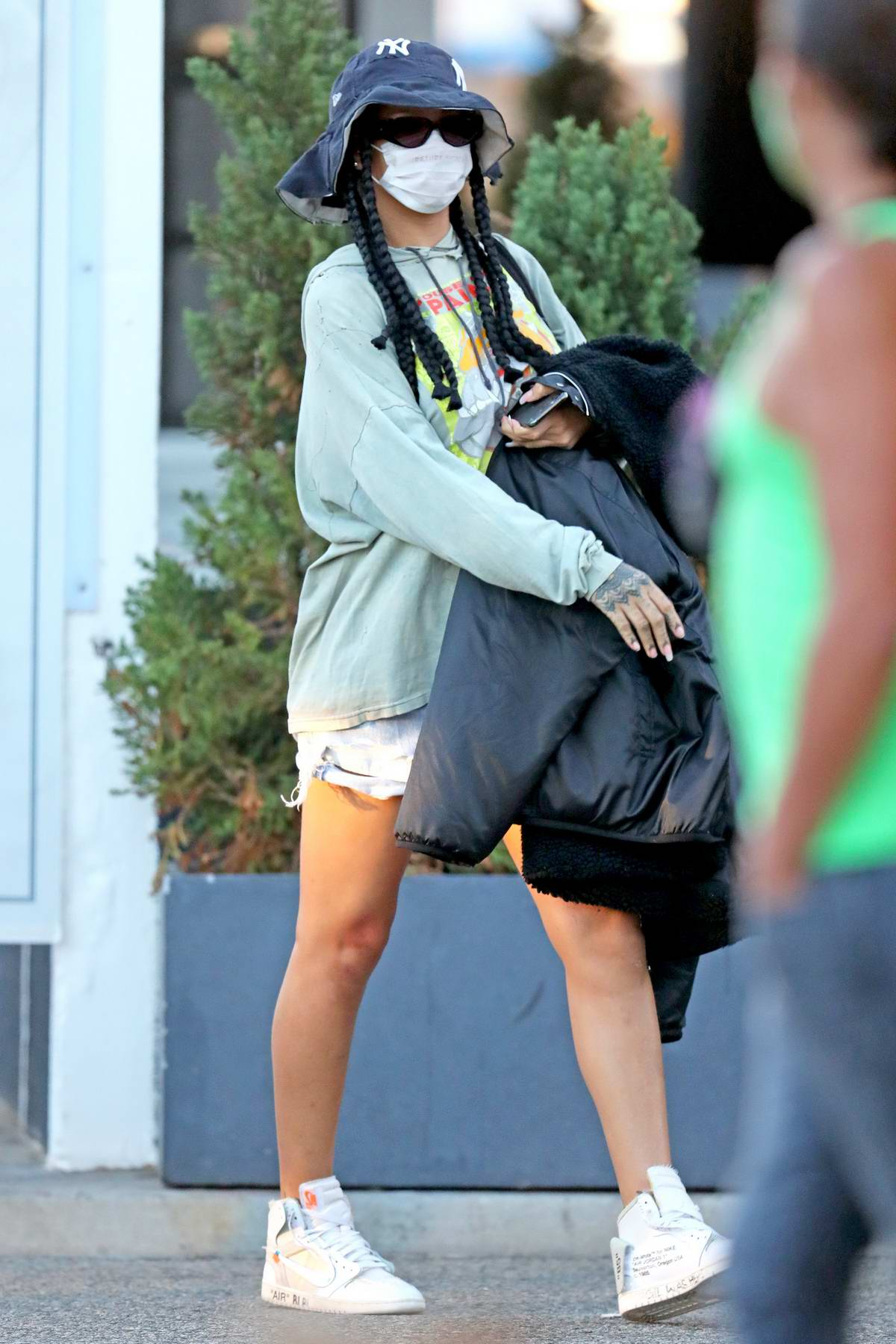 Rihanna steps out wearing a vintage hoodie and denim shorts for shopping in Los Angeles