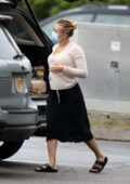 Scarlett Johansson wraps up a trip to the grocery store on a rainy day in The Hamptons, New York