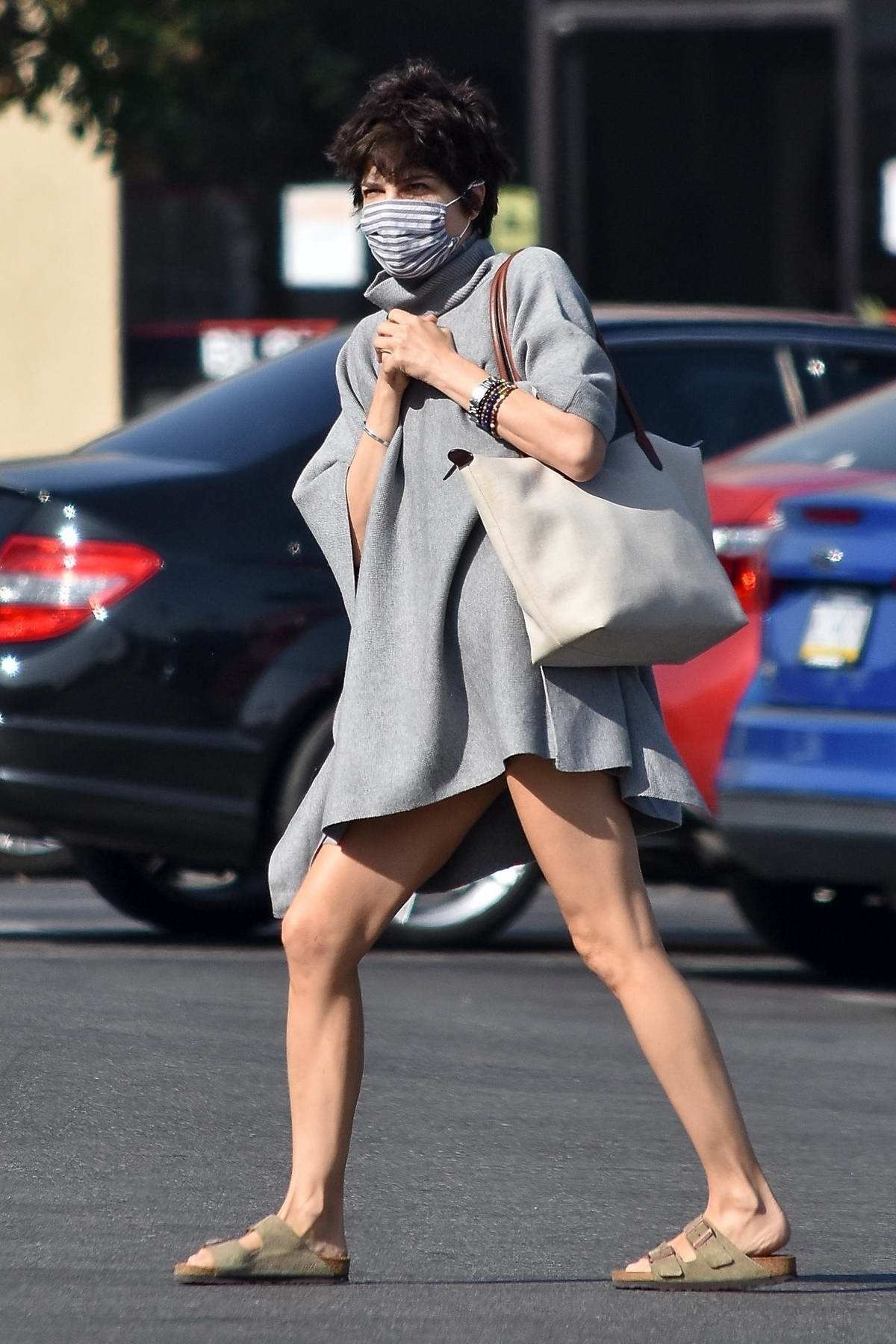 Selma Blair looks great in a gray sweater dress while making a grocery run at Trader Joes in Studio City, California