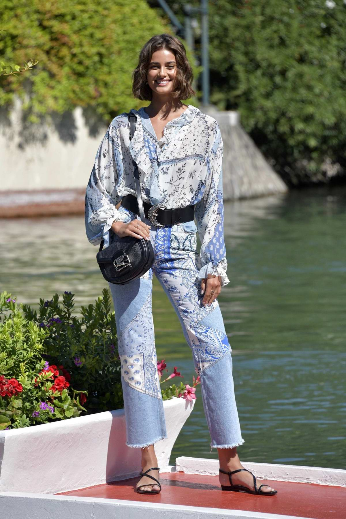 Taylor Hill is all smiles as she arrives at the 77th Venice Film Festival in Venice, Italy