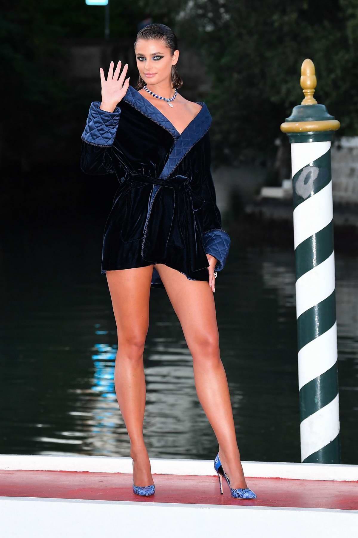 Taylor Hill looks stunning as she pose for photos at the 77th Venice Film Festival in Venice, Italy
