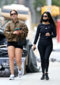 Addison Rae flaunts her legs in tiny black shorts while out for a stroll with Kourtney Kardashian in West Village, New York