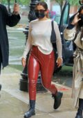 Addison Rae looks stylish in red PVC pants with semi-sheer top while arriving at the Greenwich Hotel in New York City