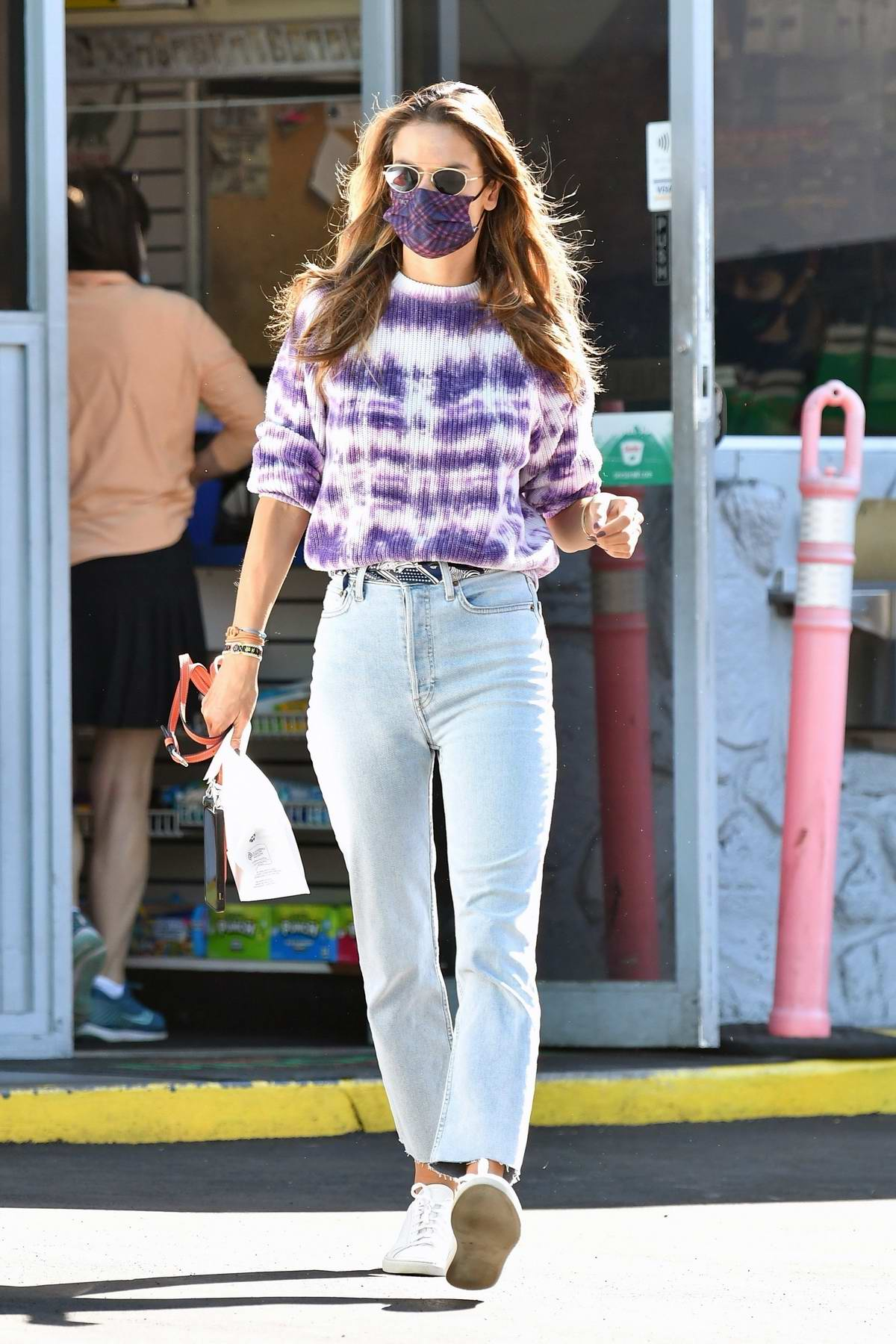 Alessandra Ambrosio looks lovely in a tie-dye top and jeans while making a quick stop at a gas station in Brentwood, California