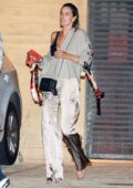 Alessandra Ambrosio looks stylish in beige silk pants during a dinner outing with friends at Nobu in Malibu, California