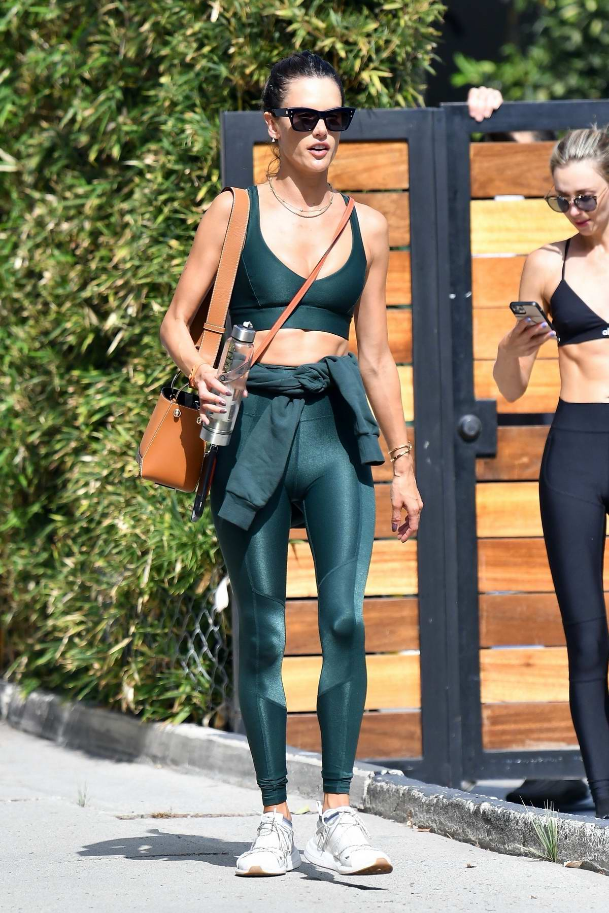 Alessandra Ambrosio rocks green sports bra and leggings for a workout session in Brentwood, California