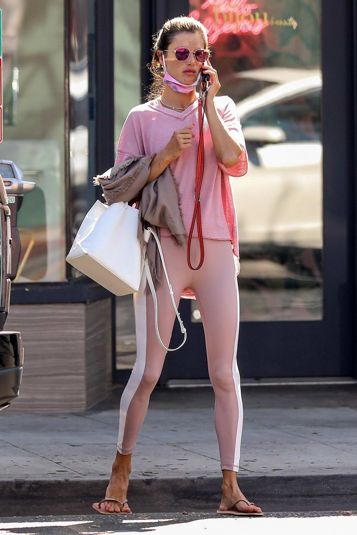 Alessandra Ambrosio sports a pink top with matching leggings while visiting Bijou Nails & Spa in Los Angeles