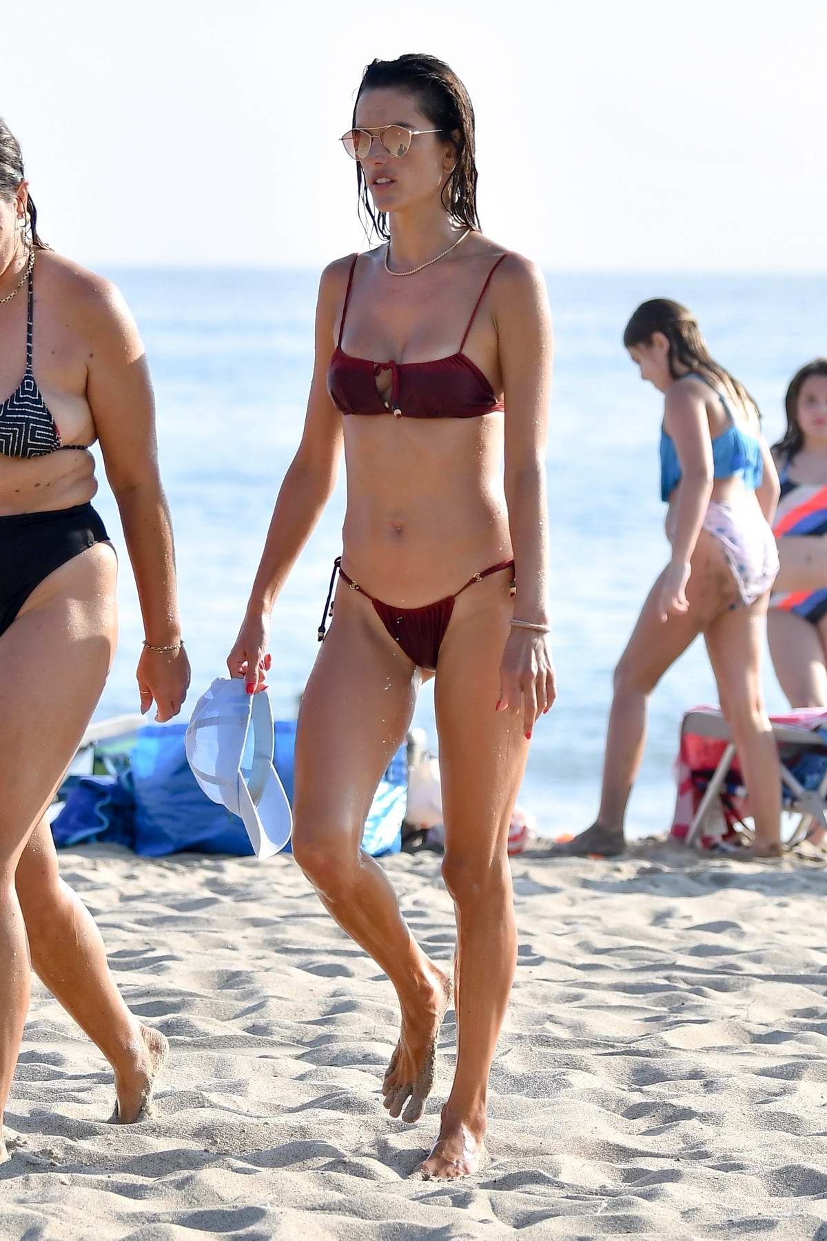 Alessandra Ambrosio stuns in a red bikini during a beach day with friends in Santa Monica, California