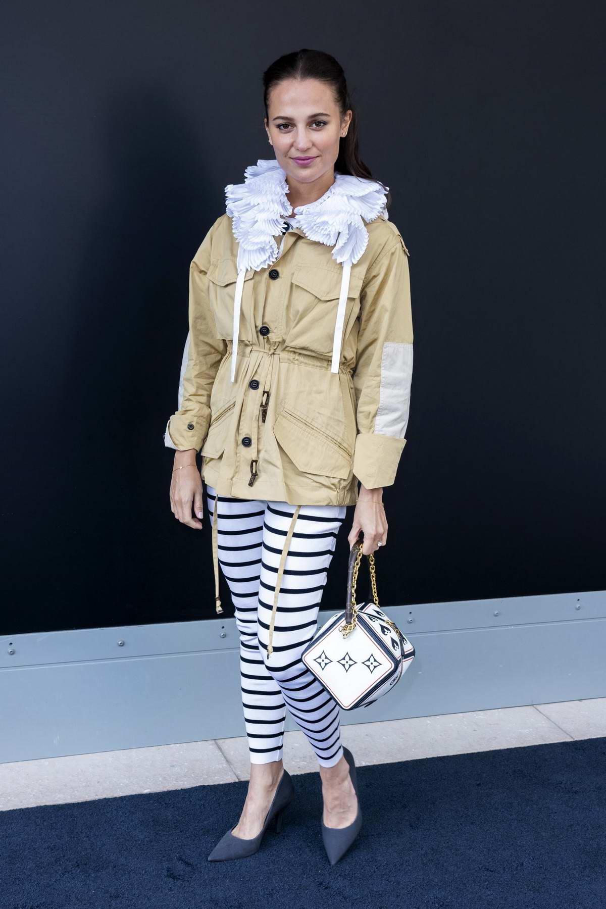 Alicia Vikander attends the Louis Vuitton Spring-Summer 2021 Show during Paris Fashion Week in Paris, France