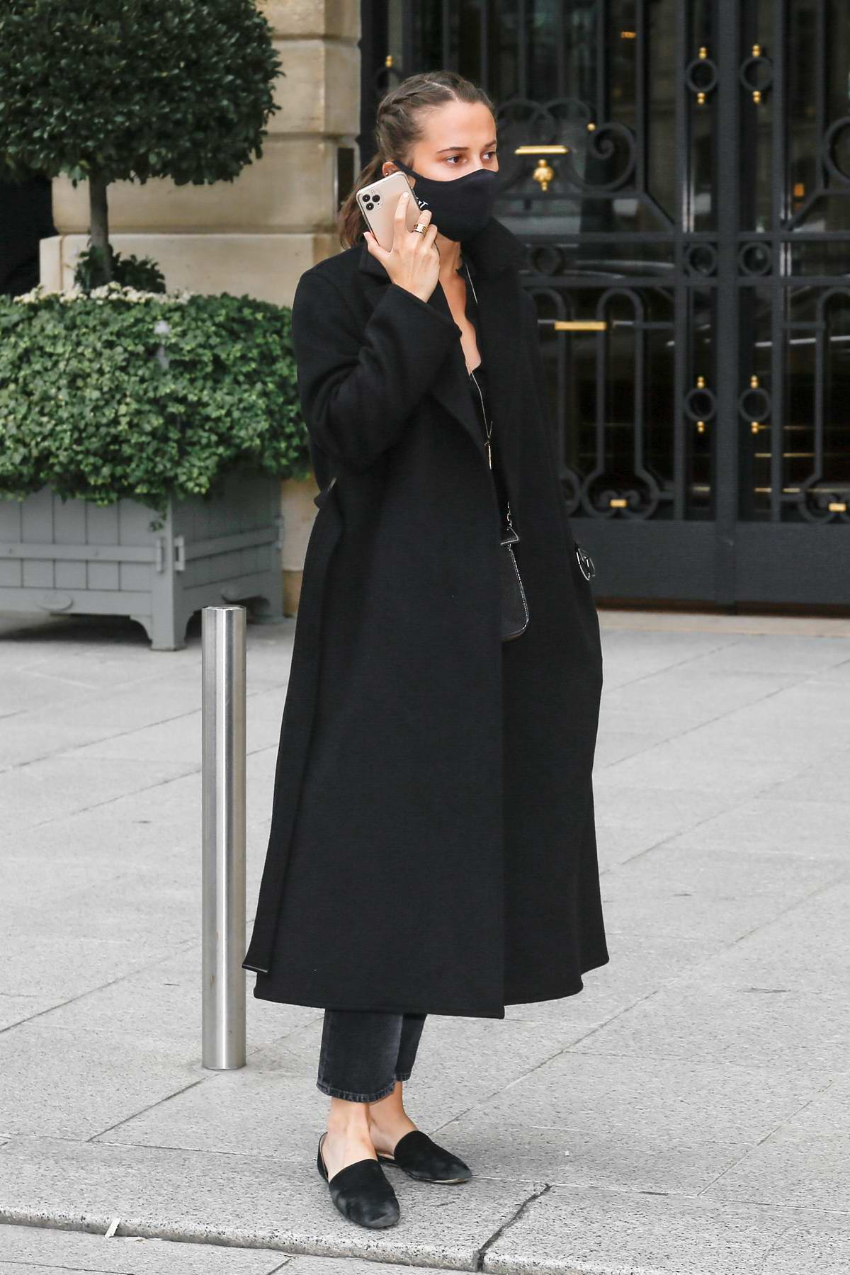 Alicia Vikander looks chic in all-black as she leaves her hotel in Paris, France