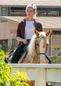Amber Heard gets some fresh air and takes her horse out for a ride at the stables in Los Angeles