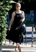 Amber Heard looks classy in a black dress as she goes to a book store with a friend in Los Feliz, California