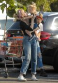 Amber Heard spends her afternoon shopping with her sister and nephew in Los Angeles