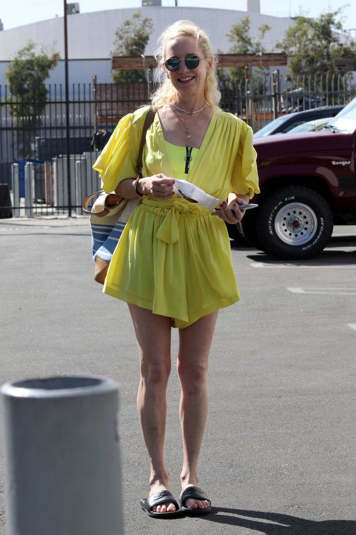 Anne Heche looks great in a yellow mini dress as she heads into DWTS Studio in Los Angeles