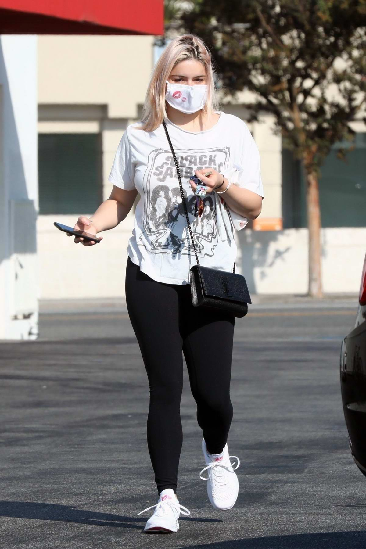 Ariel Winter keeps it casual with a tee and leggings while stopping by Rite Aid pharmacy in Los Angeles