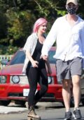 Ariel Winter shows off her bubblegum pink hair while out for a walk with friends in Los Angeles