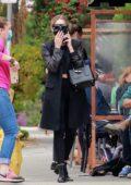 Ashley Benson dressed in all-black enjoys an alfresco lunch with a friend in Los Feliz, California