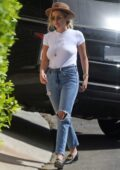 Ashley Benson grabs a coffee before taking bags into G-Eazy's house in Los Angeles
