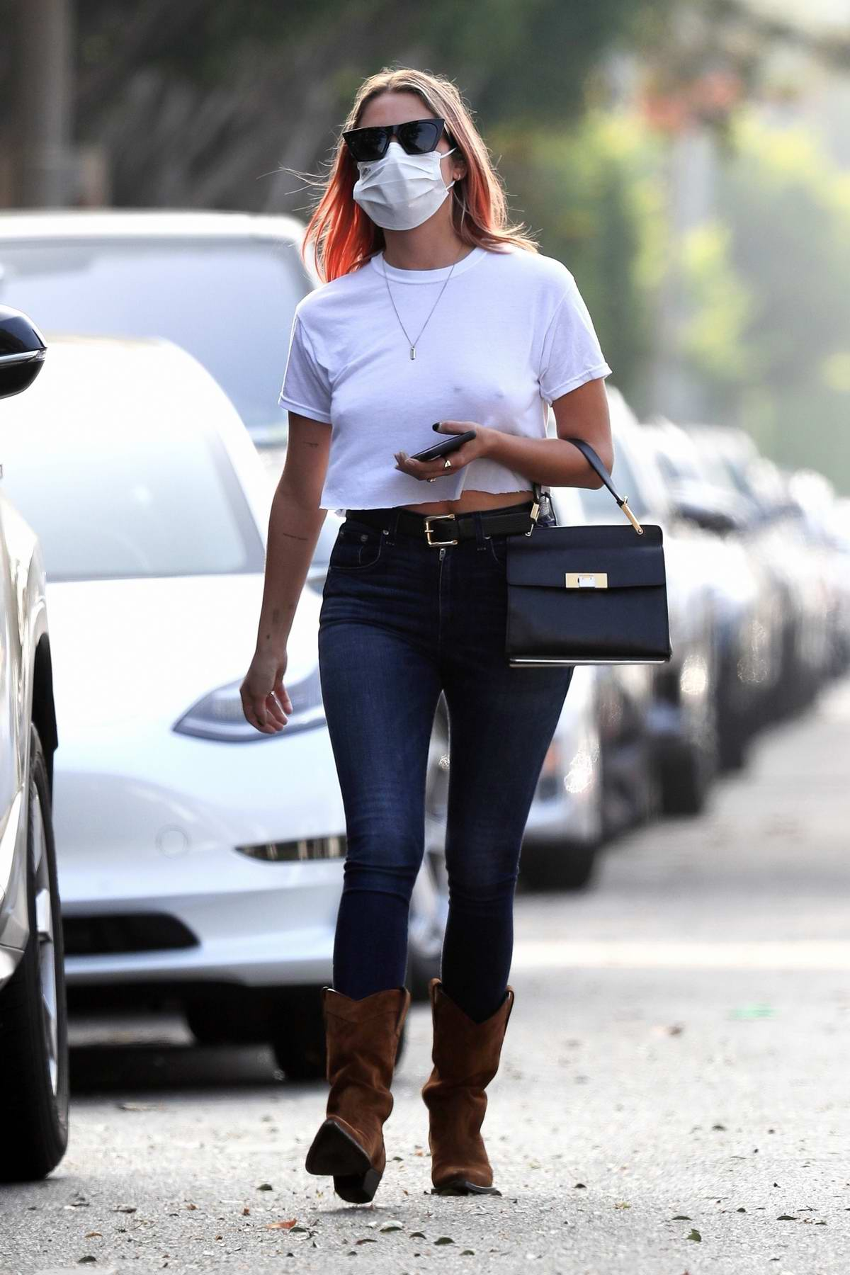 Ashley Benson wears a cropped white tee and skinny jeans while meeting friends for lunch in West Hollywood, California