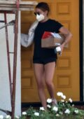 Ashley Tisdale wears tiny black shorts with matching tee while stopping by her mom's house in Toluca Lake, California