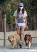Aubrey Plaza spotted in a Bob Marley t-shirt and shorts while walking her dogs in Los Angeles