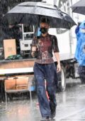Bella Hadid battles rainy weather while on set of the Michael Kors photoshoot in New York City