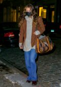 Bella Hadid keeps bundled up as she arrives at her apartment in New York City