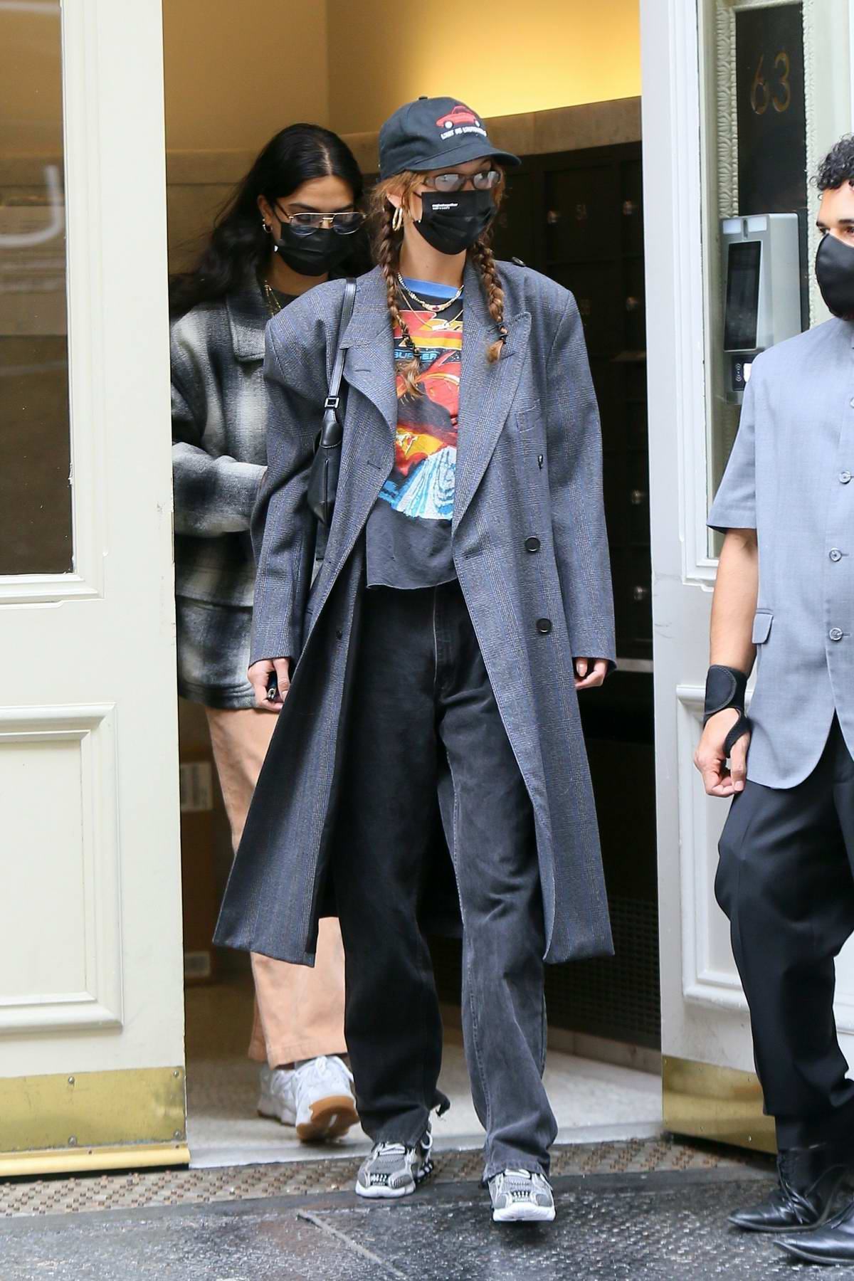 Bella Hadid seen wearing a trench coat over a graphic top while heading out to a spa in New York City