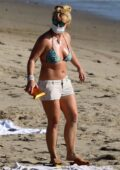 Britney Spears soaks up the sun in a bikini during beach day in Malibu, California