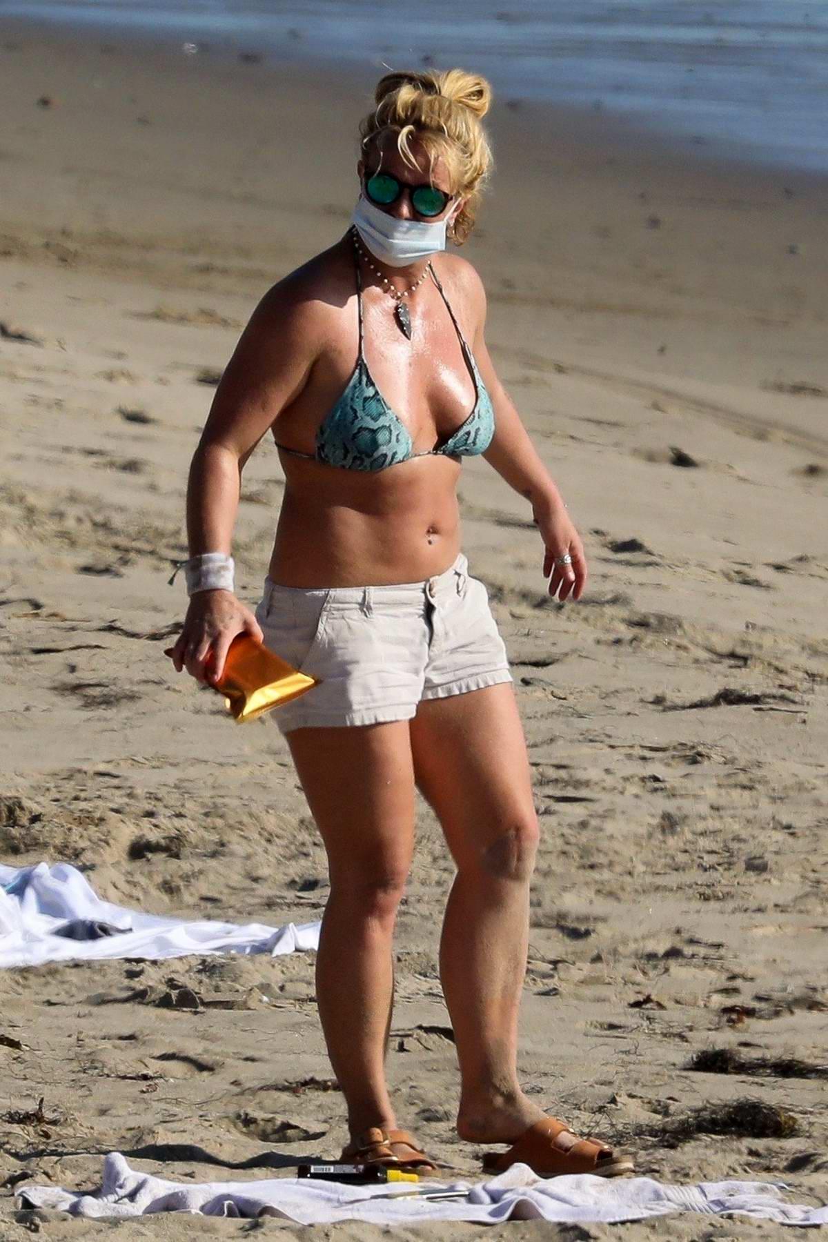 Britney Spears soaks up the sun in a bikini during beach day in Malibu, California