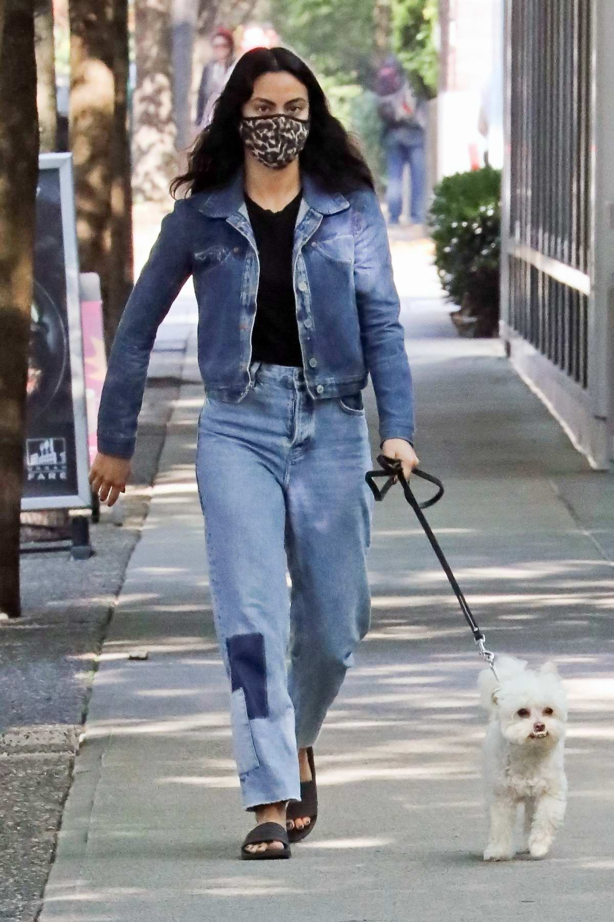 Camila Mendes dons double denim as she takes her dog Truffle for a walk in Vancouver, Canada