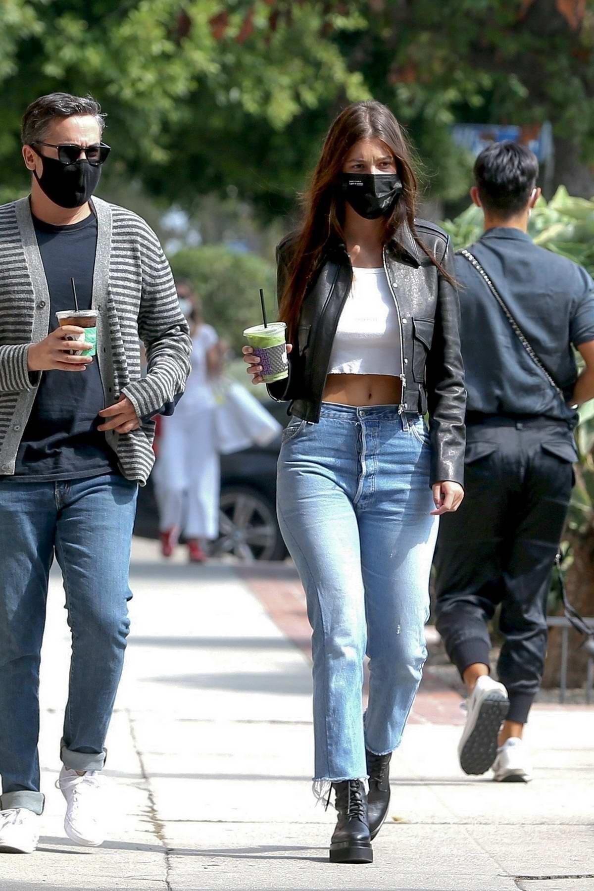 Camila Morrone flashes her midriff in a crop top while out shopping on Melrose place in West Hollywood, California