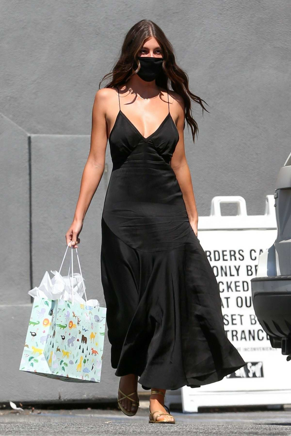 Camila Morrone looks stunning in a black dress while out shopping on Sunset Blvd in Hollywood, California