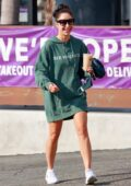 Cara Santana is all smiles as she grabs an iced coffee while out wearing 'SEE YOU IN 21' hoodie in Los Angeles