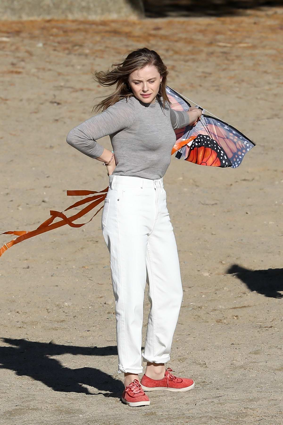 Chloe Grace Moretz seen while filming kite flying scene on the beach for 'Mother/Android' in Boston, Massachusetts