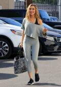 Chrishell Stause looks great in grey leggings as she walks into the DWTS Studio in Los Angeles