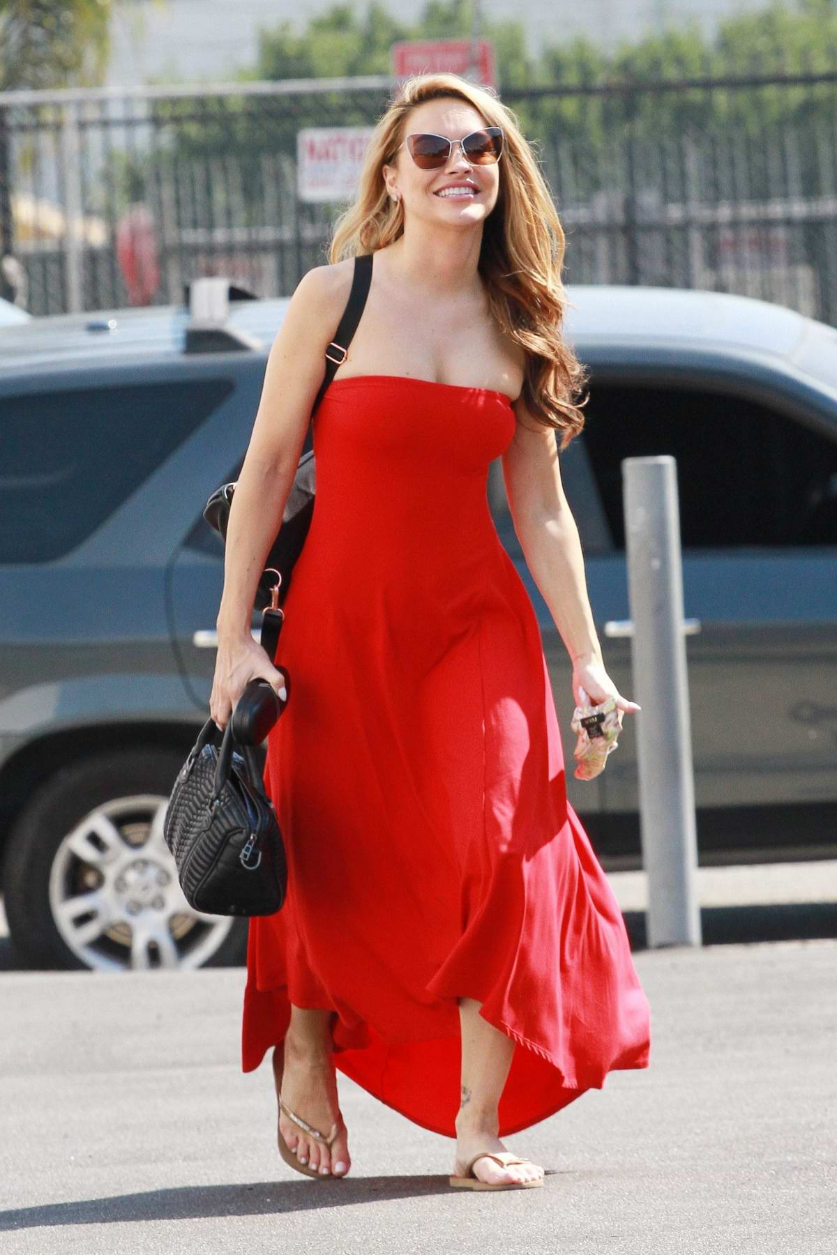 Chrishell Stause looks striking in a red dress as she heads to the DWTS studio in Los Angeles