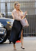Chrishell Stause wears a peach blouse and long black skirt as she arrives at the DWTS studio in Los Angeles