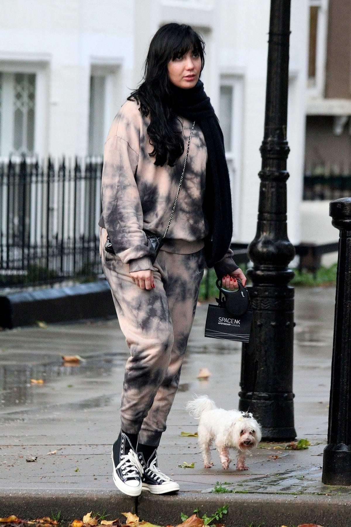 Daisy Lowe seen wearing tie-dye sweats while out for a stroll in Primrose Hill, London, UK