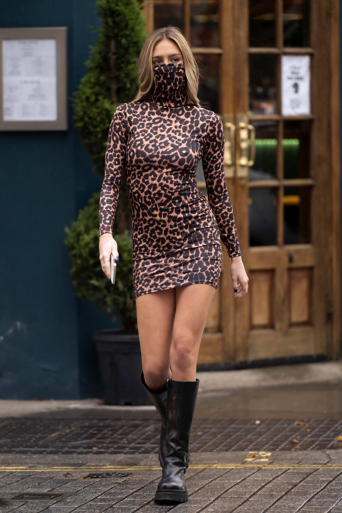 Delilah Hamlin looks stunning in PrettyLittleThing's leopard print mask dress while out in London, UK