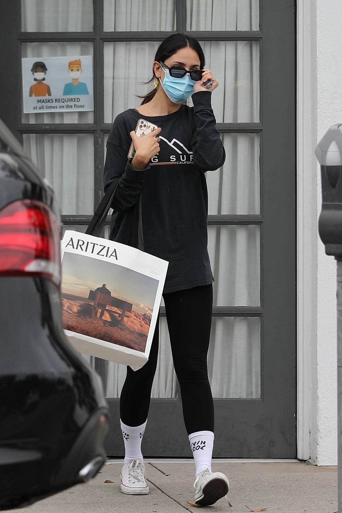 Eiza Gonzalez cuts a casual figure in a black sweatshirt and leggings while visiting her stylist in Los Angeles