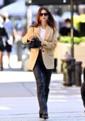 Emily Ratajkowski looks chic in a beige blazer and black leather pants as she steps out in New York City