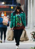 Emily Ratajkowski sports a graphic tee with green puffer jacket during a grocery run at Whole Foods in New York City