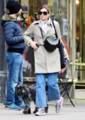 Emma Corrin looks casually chic while out for a stroll with her dog in London, UK