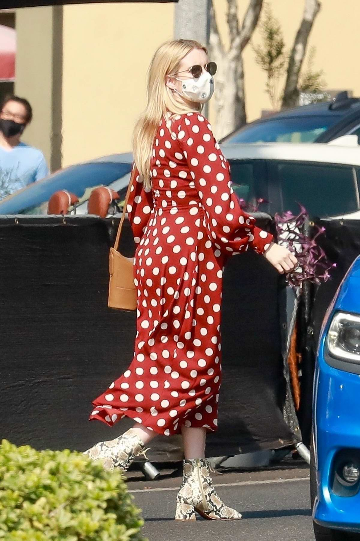Emma Roberts looks cute in a polka dot dress while running errands in Los Angeles